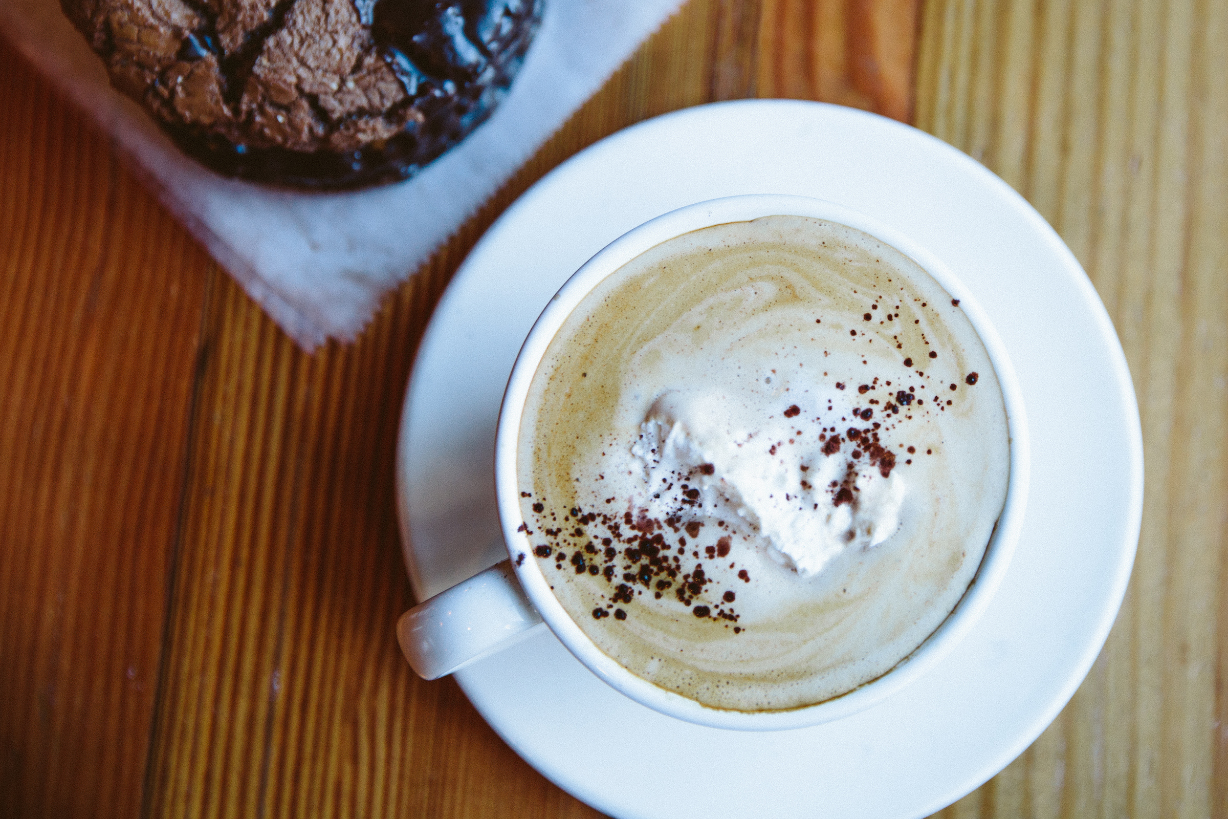 Beatrix Hot Chocolate in a mug with a sprinkling of cinnamon on top