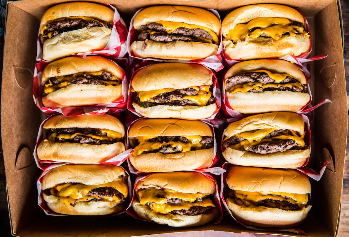 A box filled with cheeseburgers from Bub City