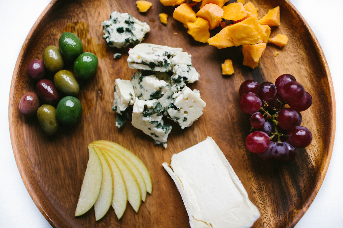 cheese, grapes, apple and olives