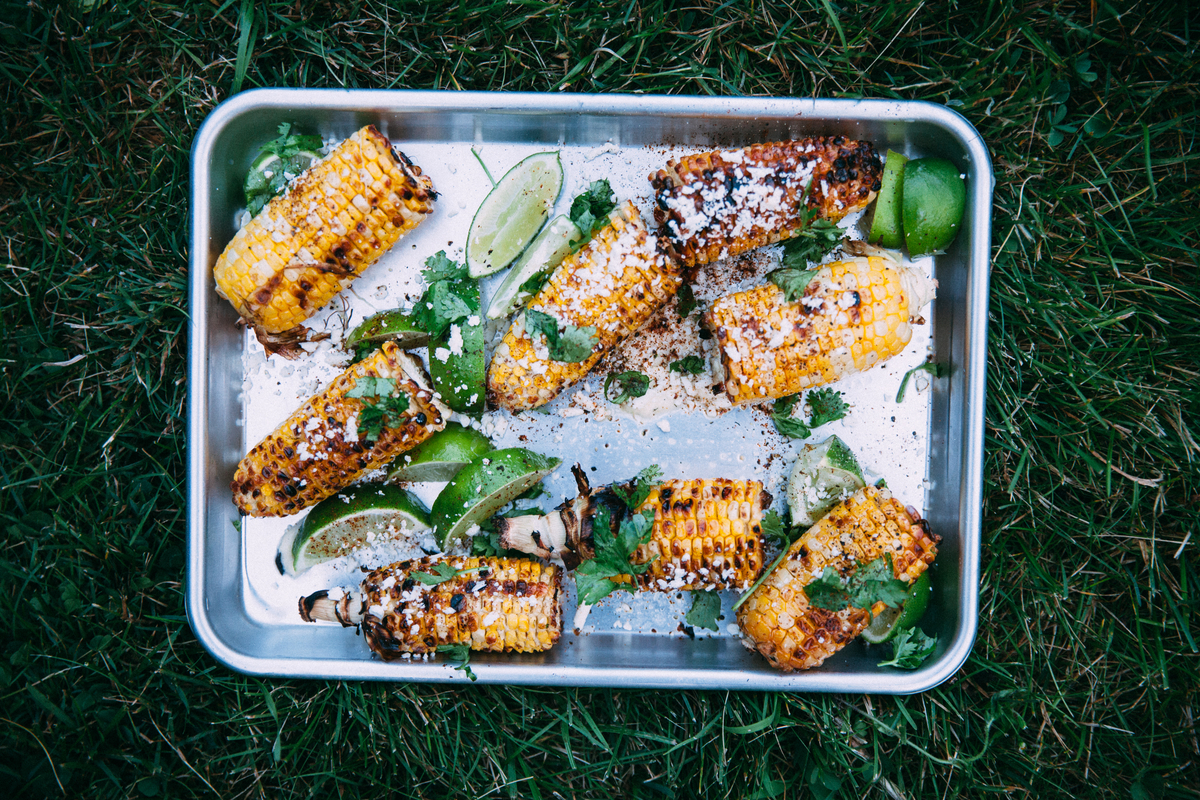 corn on a tray on grass
