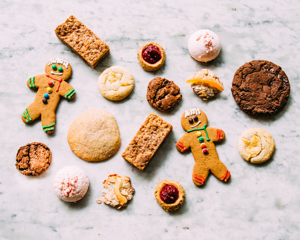 an array of holiday cookies fro gingerbread and chocolate to thumbprints