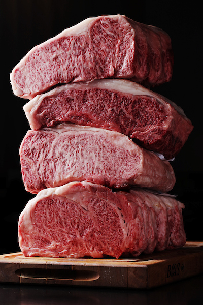 Stacks of wagyu ribeyes, raw