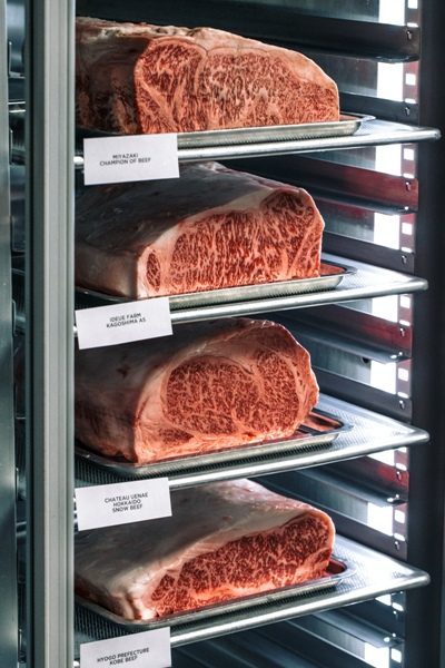 A fridge stacked with raw wagyu meat