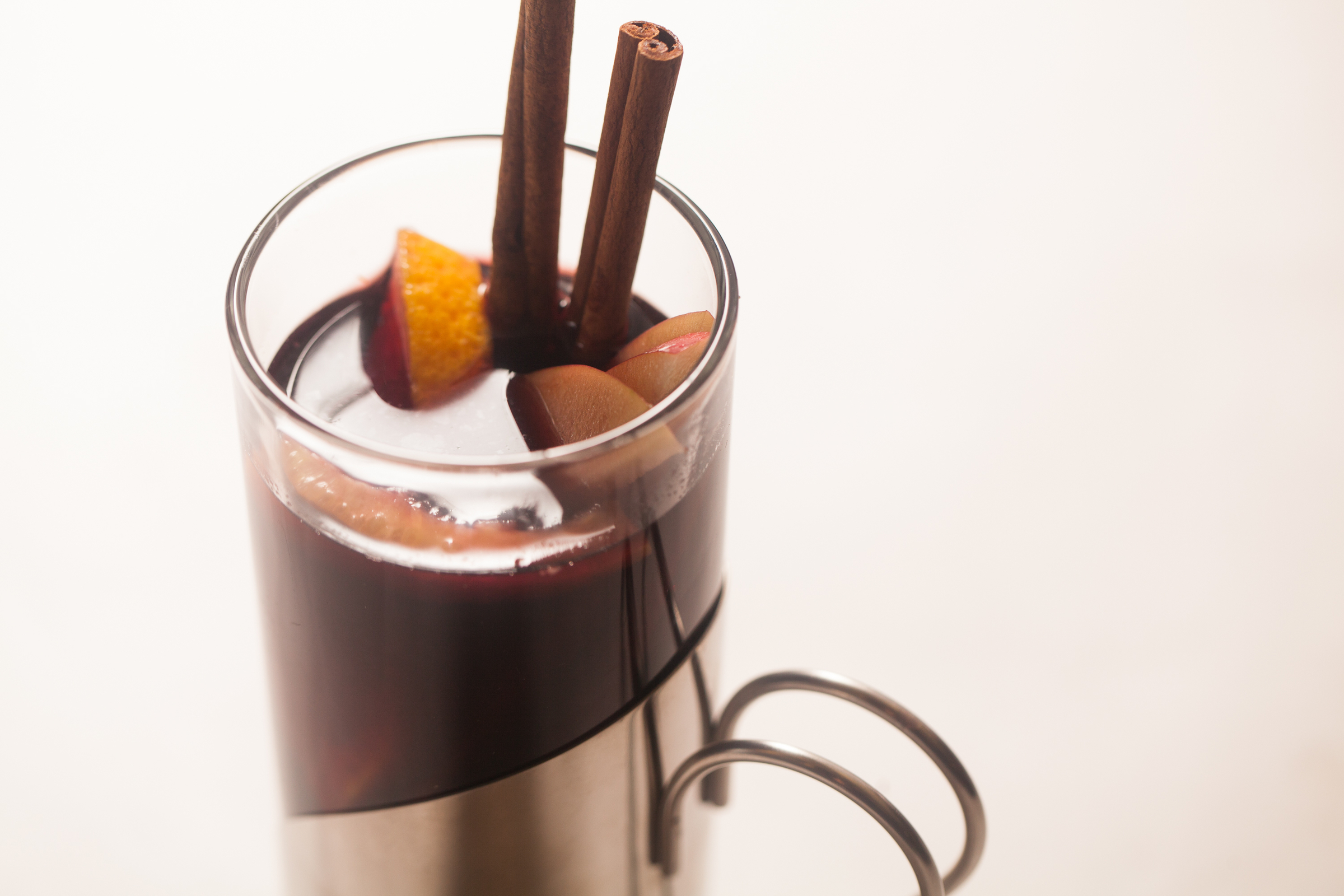 Mon Ami Gabi's Figgy Mulled Wine in a glass with cinnamon sticks sticking out