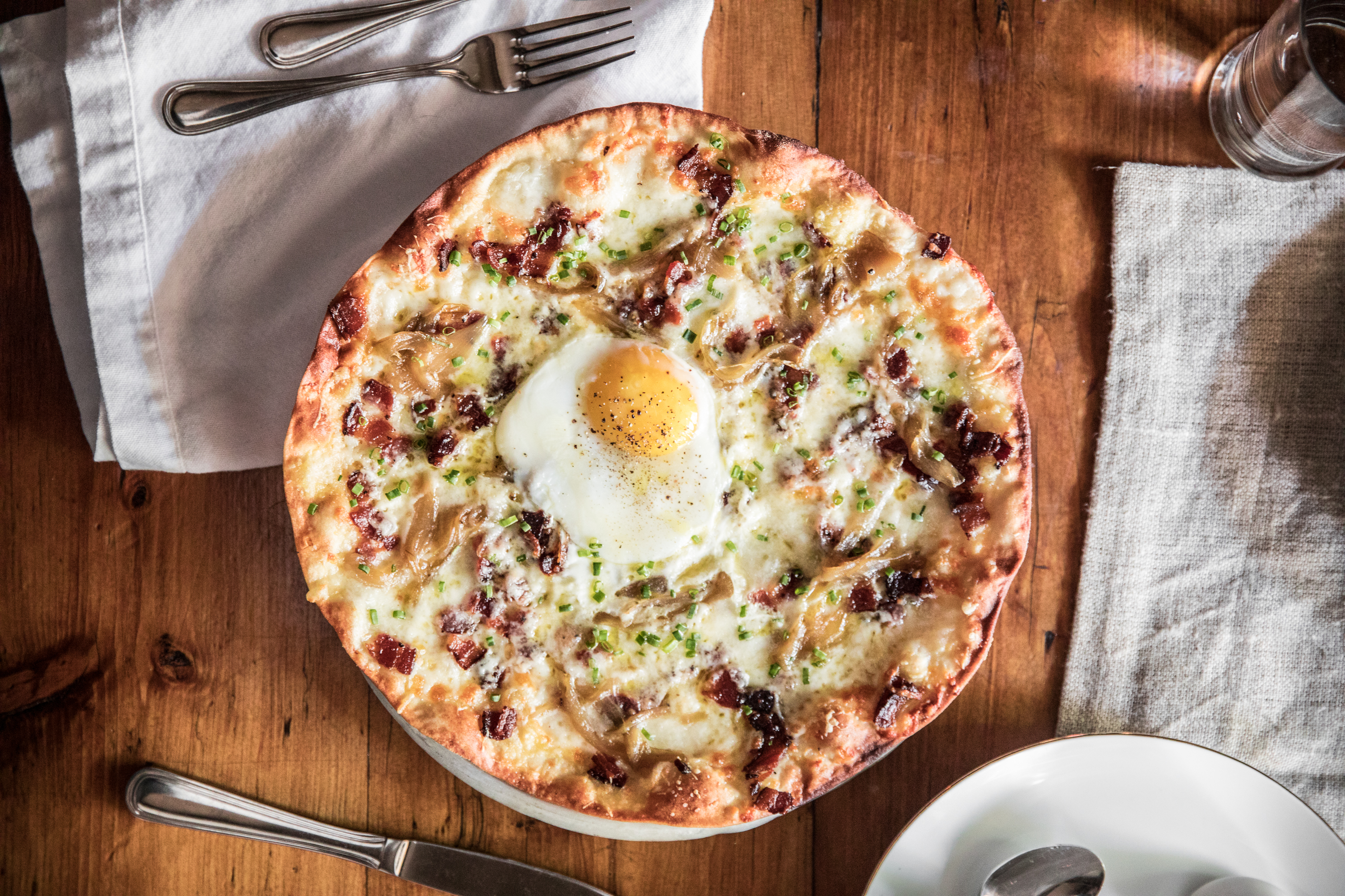 Breakfast Pizza with an egg on it