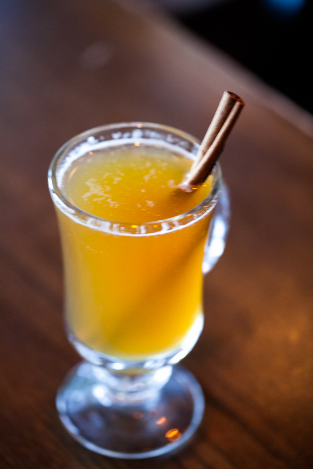 RJ Grunts' hot spiked cider with a cinnamon stick in the glass