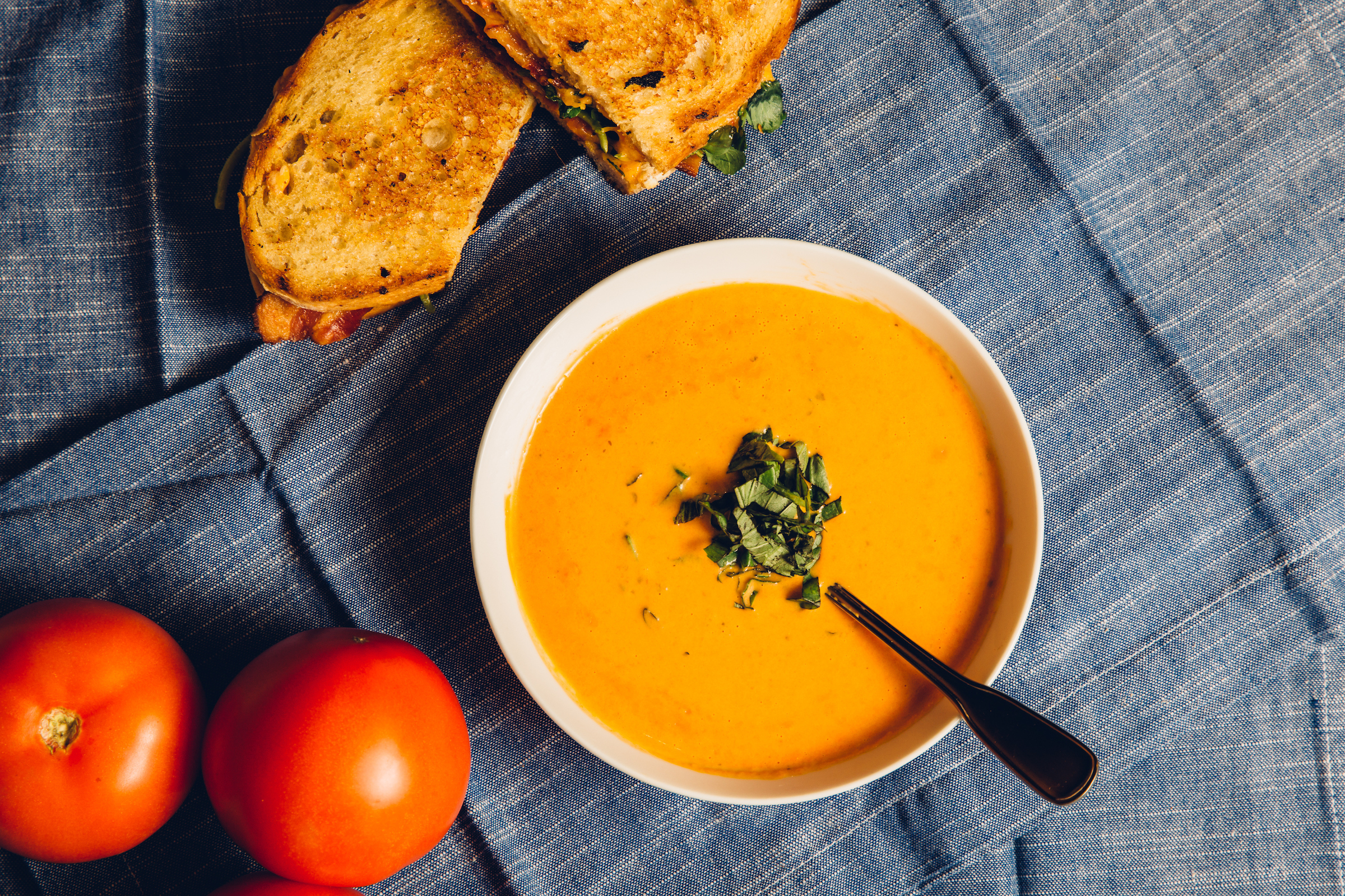 Image of soup, grilled cheese and tomatoes