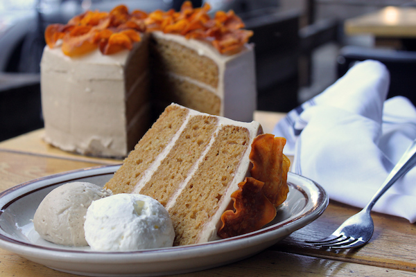 Sweet Potato Cake made with roasted sweet potatoes and accented with cinnamon and vanilla, held together with bourbon-brown sugar cream cheese frosting