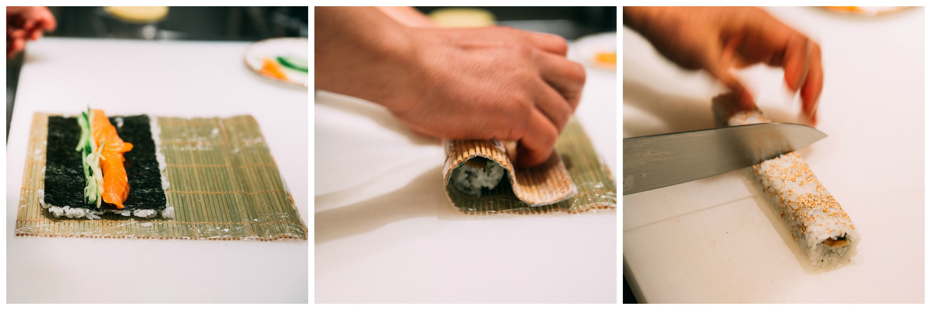 Sushi being rolled with a bamboo sheet