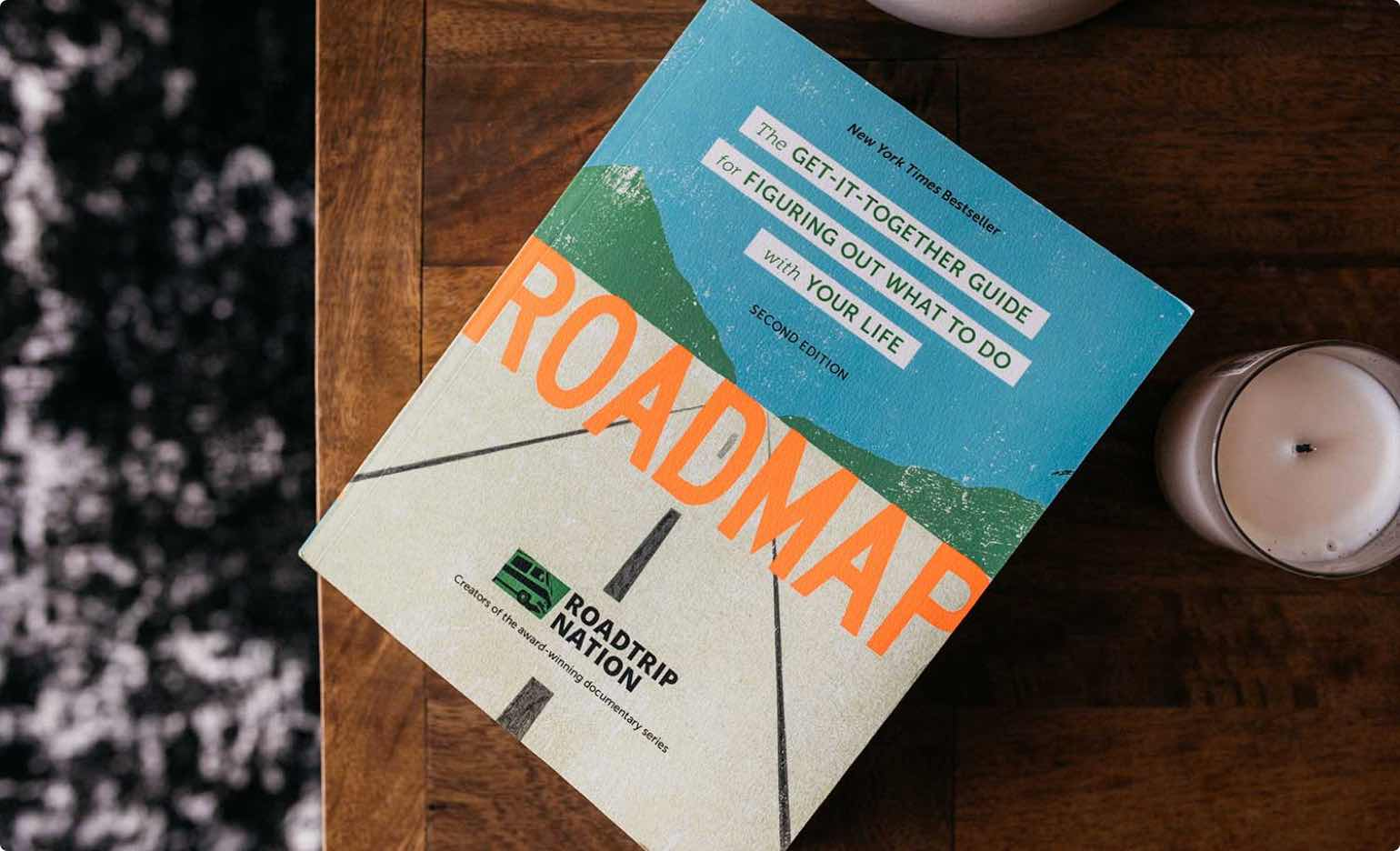 Roadmap book on a table with candles