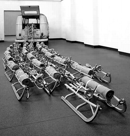 Joseph Beuys    The Pack     1969  Twenty-four sledges, resembling a pack of dogs, tumble from the back of a VW van. Each sledge carries a survival kit made up of a roll of felt for warmth and protection, a lump of animal fat for energy and sustenance, and a torch for navigation and orientation. Beuys commented: 'This is an emergency object: an invasion by the pack. In a state of emergency the Volkswagen bus is of limited usefulness, and more direct and primitive means must be taken to ensure survival.'  Source: [](http://www.tate.org.uk/modern/exhibitions/beuys/room6.shtm)[http://www.tate.org.uk/modern/exhibitions/beuys/room6.shtm](http://www.tate.org.uk/modern/exhibitions/beuys/room6.shtm)