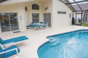 Champions Gate's Retreat Resort - 8 Bedroom Private Pool Home, 7 Seat Home Theatre - JHH 45966