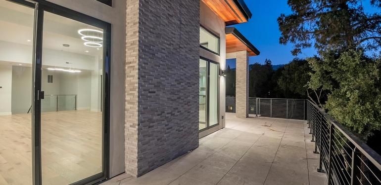 1669_Whitham_Ave_Los_Altos_CA-large-025-025-Living_Room_Patio_View_at_Dusk-1499x1000-72dpi.jpg