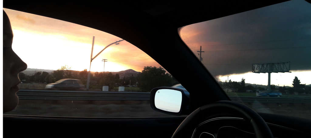 photo of sunset through Loma Prieta Fire from car window