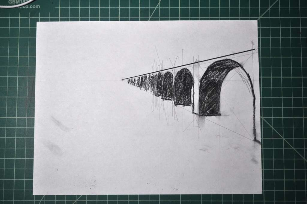 pencil and charcoal drawing calculating the perspective of the arches leading into the background
