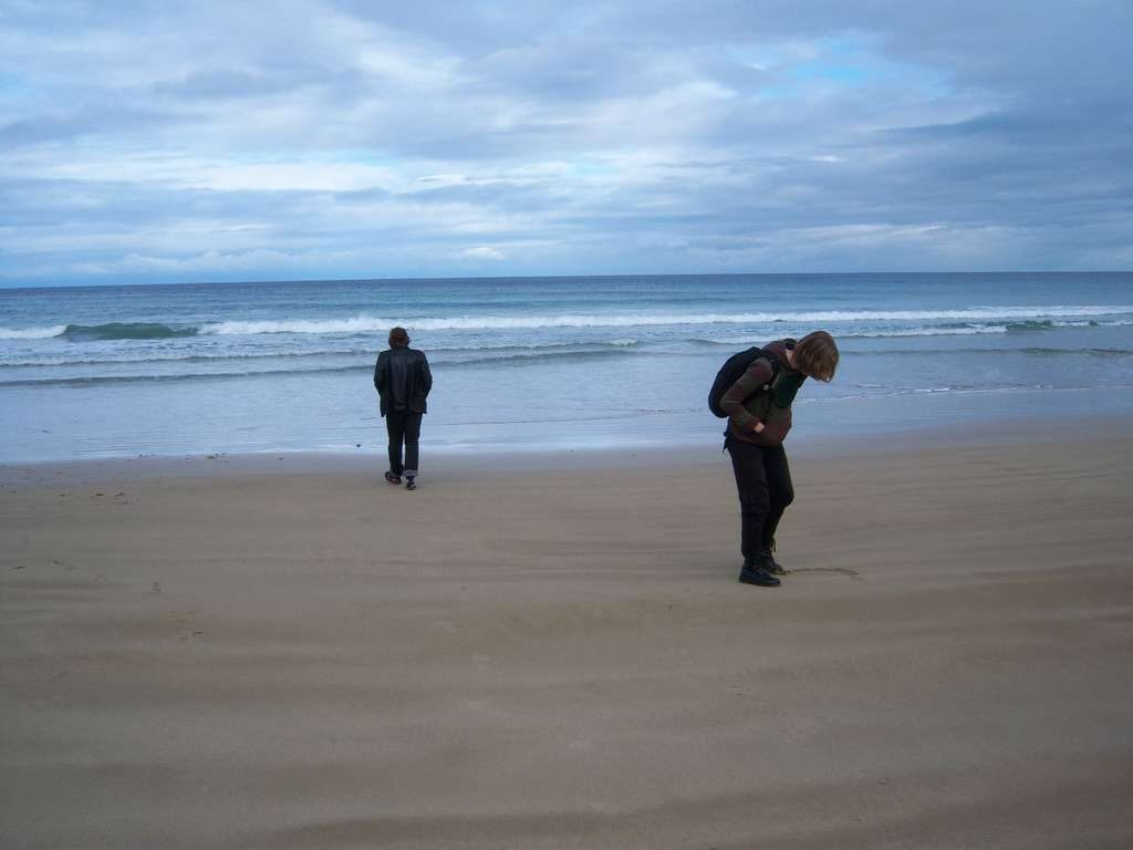 photo of two people on a beach