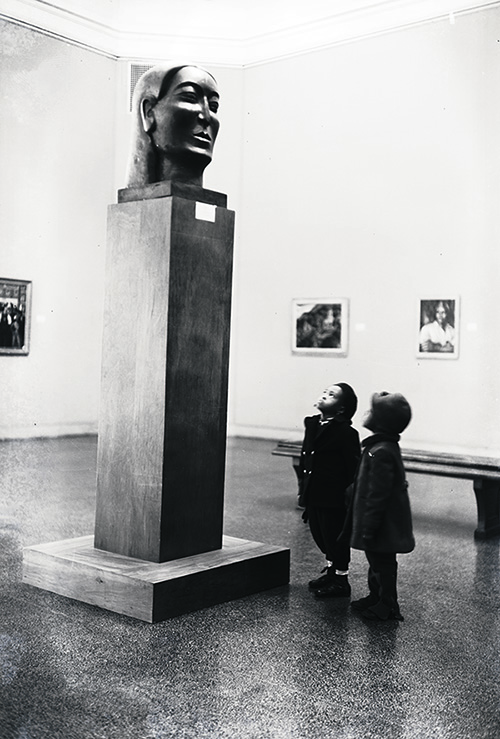 Children viewing Ronald Moody's Midonz (1937) at The Baltimore Museum of Art's Contemporary Negro Art exhibition. 1939.