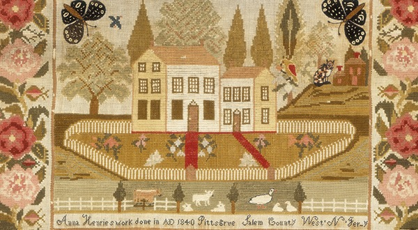 An embroidery featuring a home, some birds and some butterflies.