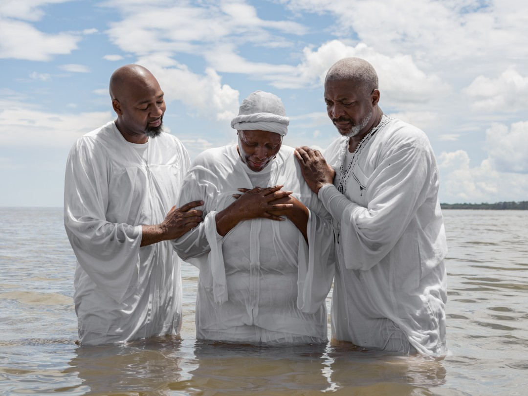 """True Life Ministries holds a Baptism in Georgia near former cotton plantations. Rev. Ambrose Carroll said, """"We're ex-slaves, migrant farmers with our hands in the ground. We don't talk the language of environmentalism, but it's close to who we are."""""""