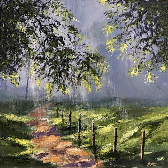Shafts of sunlight on a misty day