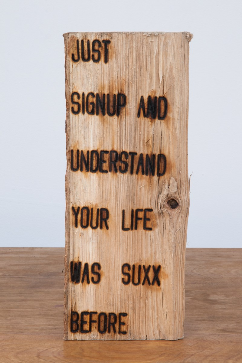 """Artwork – Branding Project #4:  I swear somewhere the truth lies within this wood - """"JUST SIGNUP AND UNDERSTAND YOUR LIFE WAS SUXX BEFORE"""", 2012"""