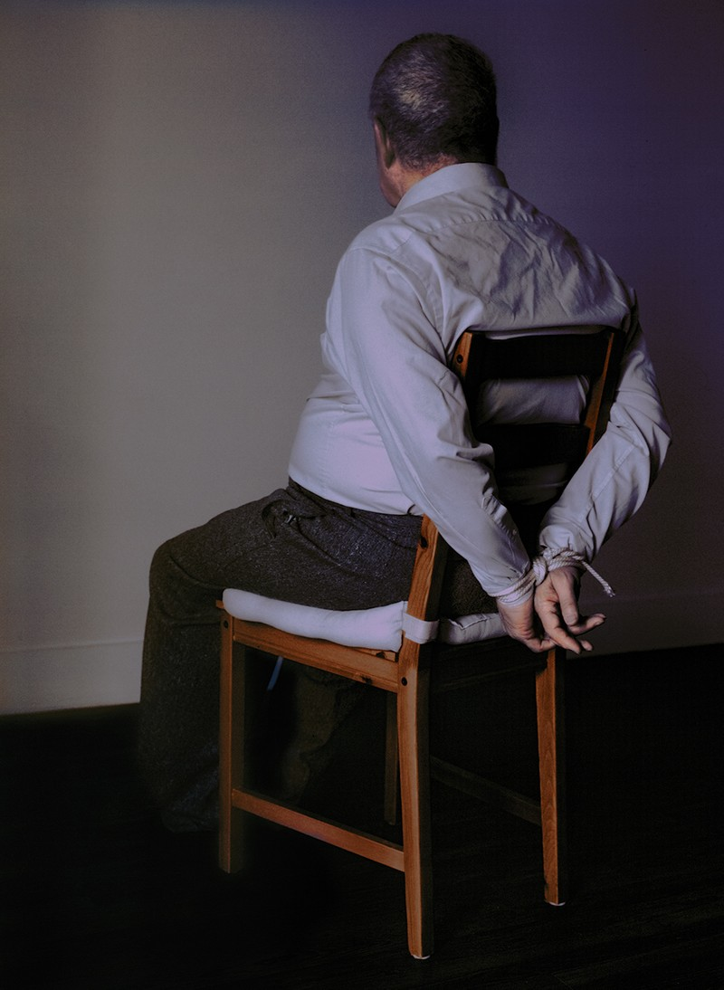 Artwork – Man Sitting in Chair with Hands Bound, 2020