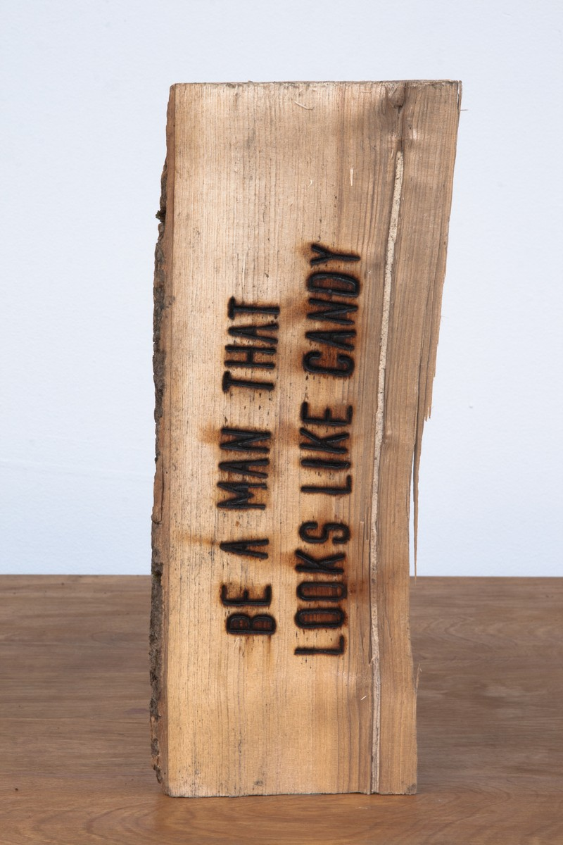 """Artwork – Branding Project #4:  I swear somewhere the truth lies within this wood - """"BE A MAN THAT LOOKS LIKE CANDY"""", 2012"""