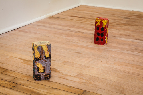 in Pictures for Macho Man, Tell It To My Heart: Collected by Julie Ault at Artists Space. Image for Tim Rollins + K.O.S., Untitled (Bricks), 1980, Tempera, acrylic on found brick, Gift of Time Rollins to Julie Ault, 1980. Macho Man, Tell It To My Heart: Collected by Julie Ault, Artists Space, 2013. Photo by Daniel Pérez, courtesy Artists Space.