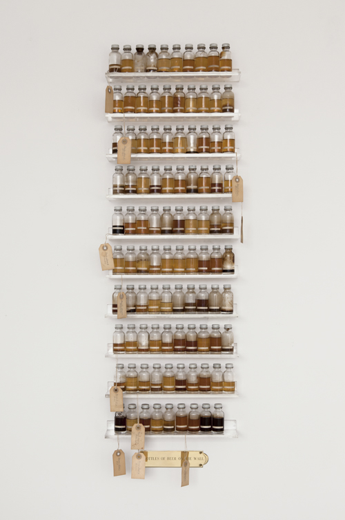 in Pictures for Candy Jernigan at Greene Naftali Gallery. Image for Candy Jernigan, 99 Bottles of Beer on the Wall, c. 1988-89, Beer, glass vials, packing tags and Plexiglas shelves, 48 x 14 x 3 1/2 inches (121.9 x 35.6 x 8.9 cm). Courtesy of Greene Naftali, New York.