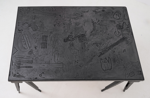 in Pictures for 'Particular Pictures' at The Suzanne Geiss Company. Image for Lukas Geronimas, Custom Table, 2013, Wood, Plaster, Brass, Ink, Graphite Powder, 38 x 63 x 30 inches (96.5 x 160 x 76.2 cm). Photo Adam Reich. Courtesy The Suzanne Geiss Company.