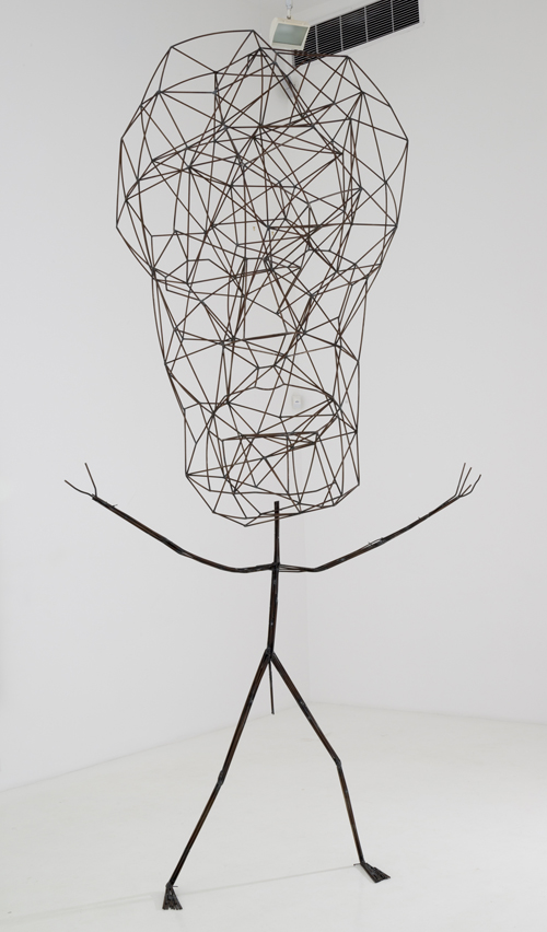 in Pictures for 'Particular Pictures' at The Suzanne Geiss Company. Image for Jonathan Borofsky, Space Head at 2,968,932, 1986, Welded steel rod, Approx. 130 x 72 x 48 inches overall Approx. 330.2 x 182.88 x 121.92 cm overall, Head: 82 x 41 x 48 inches; Torso: 68 x 72 x 18 inches. Photo Adam Reich. Courtesy The Suzanne Geiss Company.