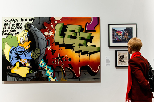 in Pictures for City as Canvas at The Museum of the City of New York. Image for Display of work by graffiti artist Lee Quinones including  a canvas titled Howard the Duck, a sketch titled the Lion's Den Study #2, and a photograph of Lion's Den Handball Court mural photographed by Charlie Ahearn. Image by Liz Ligon. Courtesy of the Museum of the City of New York.