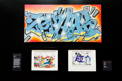 in Pictures for City as Canvas at The Museum of the City of New York. Image for Top: Acrylic paint on canvas by graffiti artist Zephyr. Left to right: Drawings by graffiti artists Sane Smith and Dondi. Image by Liz Ligon. Courtesy of the Museum of the City of New York.