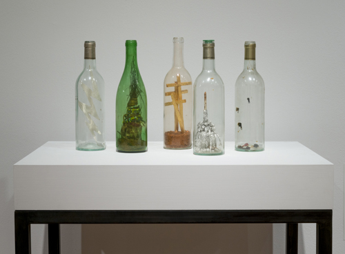 in Pictures for 'When the Stars Begin to Fall: Imagination and the American South' at The Studio Museum in Harlem. Image for David Hammons, Untitled (Bottles), 1985, Cigar, dirt, balsa wood, tinfoil and mixed-media figurines in glass bottles, Dimensions variable. Collection of Hudgins Family. Photo: Adam Reich