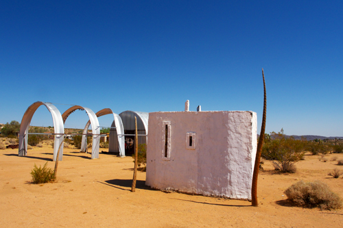in Pictures for 'When the Stars Begin to Fall: Imagination and the American South' at The Studio Museum in Harlem. Image for Noah Purifoy, Desert Art Museum, 1989–2004, Digital slides and titles, Dimensions variable. Courtesy the Noah Purifoy Foundation