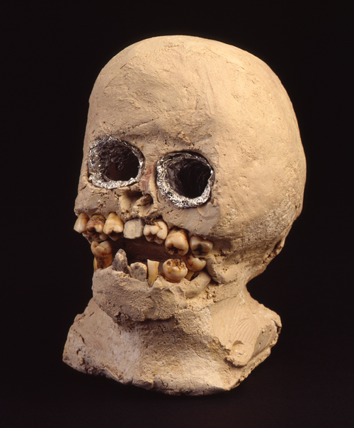 "in Pictures for 'When the Stars Begin to Fall: Imagination and the American South' at The Studio Museum in Harlem. Image for James ""Son"" Thomas, Skull, 1988, Unfired clay, human teeth, rocks and aluminum foil, 7 x 4 1⁄2 x 7 in. The William Arnett Collection of the Souls Grown Deep Foundation"