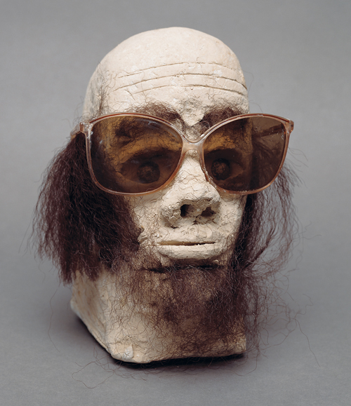 "in Pictures for 'When the Stars Begin to Fall: Imagination and the American South' at The Studio Museum in Harlem. Image for James ""Son"" Thomas, Untitled, 1987, Unfired clay, artificial hair, sunglasses and glass marbles, 9 × 7 × 7 in. The William Arnett Collection of the Souls Grown Deep Foundation"