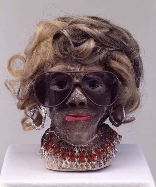 "in Pictures for 'When the Stars Begin to Fall: Imagination and the American South' at The Studio Museum in Harlem. Image for James ""Son"" Thomas, Untitled, 1987, Unfired clay, artificial hair, sunglasses, wire, aluminum foil, beads, glass marbles and paint, 9 1⁄2 × 8 × 8 3⁄4 in. The William Arnett Collection of the Souls Grown Deep Foundation"