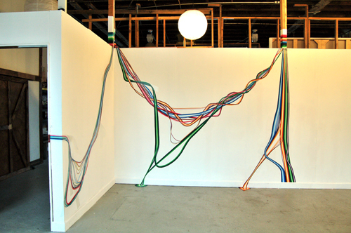 in Pictures for 'Inhabiting Ten Eyck' at Storefront Ten Eyck. Image for   Dave Eppley, Slack, 2014, vinyl on wall, wood and conduit dimensions variable. Courtesy of Storefront Ten Eyck.