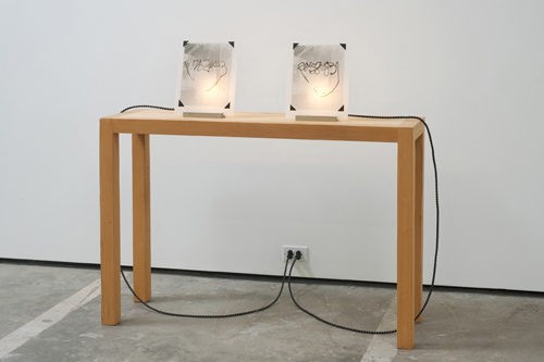 in Pictures for 'The Photographic Object, 1970' at Hauser & Wirth. Image for Richard Jackson, Negative Numbers, 1970 / 2011, Film negative, light, electric cord, porcelain, wood stand, 113 x 121.9 x 35.6 cm / 44 1/2 x 48 x 14 in, Installation view, Cherry and Martin, Los Angeles CA, 2011 © Richard Jackson. Courtesy Cherry and Martin. Photo: Robert Wedemeyer.