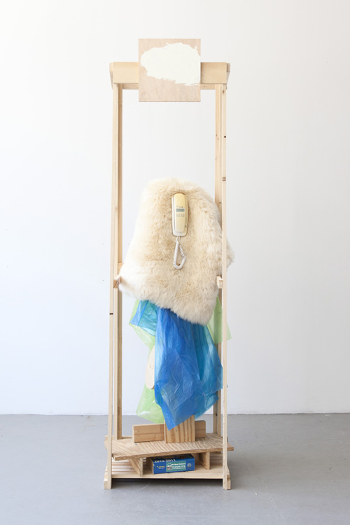 in Pictures for 'Displayed' at Anton Kern Gallery. Image for Rachel Harrison, Caller ID, 2014, Wood, plastic, fake fur, telephone book, and telephone book, 88 1/4 x 27 1/2 x 19 3/4 inches (224.2 x 69.9 x 50.2 cm). Courtesy the artist.