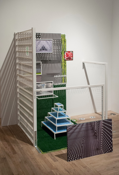 in Pictures for 'This is what sculpture looks like' at Postmasters Gallery. Image for Diana Cooper, Cubicle, 2014, digital prints, vinyl, plastic gutter guards, stainless steel spikes, plastic, acrylic paint, felt tip markers, vinyl tape, wood, metal hardware, numbered map pins and corrugated plastic, 74 x 74 x 70 inches. Courtesy of Postmasters Gallery.