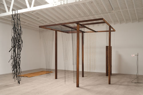 in Pictures for 'Beyond the Supersquare' at The Bronx Museum of the Arts. Image for Leonor Antunes, assembled, moved, re-arranged and scrapped continuously, 2012, Walnut and stainless steel installation with brass tube netting, 109.5 x 118 x 118 inches. Courtesy of Marc Foxx Gallery, Los Angeles.