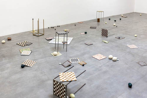 in Pictures for 'The St. Petersburg Paradox' at The Swiss Institute. Image for Sarah Ortmeyer, SANKT PETERSBURG PARADOX, 2014. Marble chessboards; copper, iron, brass and aluminum chess tables; natural (ostrich, rhea, goose, chicken, mallard, quail, emu, and duck) eggs; artificial (marble obsidian, alabaster, and onyx) eggs Dimensions variable. Courtesy the artist and Dvir Gallery, Tel Aviv.