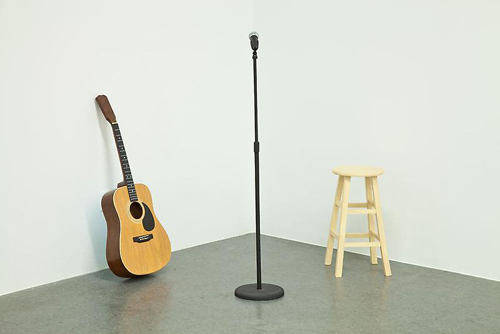 in Pictures for Tom Friedman at Luhring Augustine Bushwick. Image for Tom Friedman, Moot, 2014, Paint and Styrofoam, Guitar: 41 3/8 x 15 5/8 x 4 3/4 inches, Mic: 54 1/2 x 10 1/2 x 10 1/4 inches, Stool: 23 1/4 x 12 1/4 x 12 1/4 inches. Courtesy of the artist and Luhring Augustine, New York.