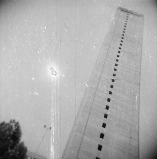 "in Pictures for 'Here and Elsewhere' at The New Museum. Image for Ziad Antar, Murr Tower, Wadi Abu Jmil, Built In 1973, from the ""Expired"" series, 2009. Gelatin silver print, 19 3/4 x 19 3/4 in (50 x 50 cm). Courtesy the artist and Selma Feriani Gallery, London"