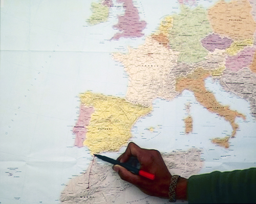 "in Pictures for 'Here and Elsewhere' at The New Museum. Image for Bouchra Khalili, Mapping Journey #7, from ""The Mapping Journey Project,"" 2008–11 (still). Video, color, sound; 6 min. Courtesy the artist and Galerie Polaris, Paris"