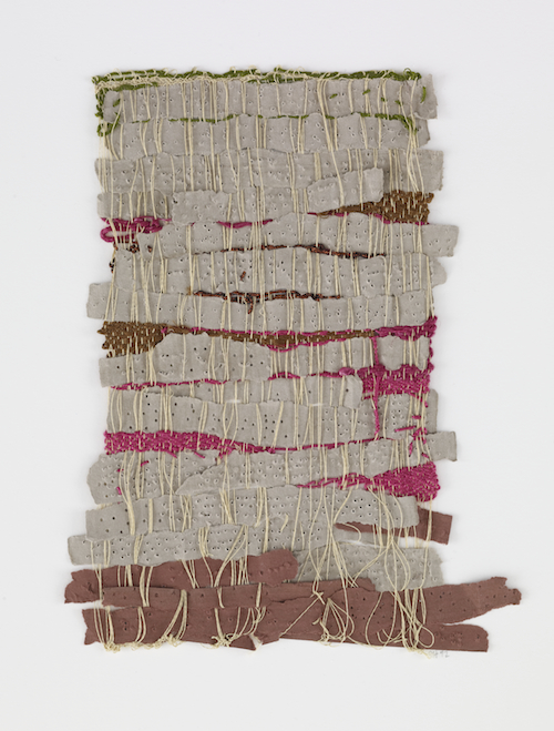 in Pictures for 'Thread Lines' at The Drawing Center. Image for Sheila Hicks, Punched Notations, 2012. Paper and synthetic yarn, 9 1/2 x 7 1/2 inches. Andrea and José Olympio Pereira Collection.