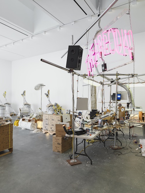 in Pictures for Jason Rhoades at David Zwirner. Image for Jason Rhoades, Installation view of The Grand Machine / THEAREOLA (2002), Mixing Desk and Chair / Yellow Ribbon in Her Hair (2002), PeaRoeFoam Bulk Pallet (2002) and PeaRoeFoam Pallet with Sculpture from Vienna (2002) from the 2014 solo show Jason Rhoades: PeaRoeFoam at David Zwirner, NY