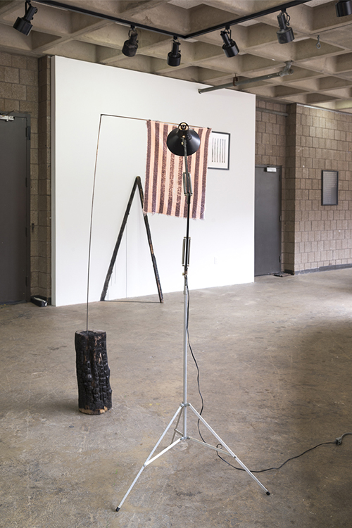 in Pictures for 'GEOMETRIES OF INTIMACY' at Abrons Arts Center. Image for Lisa and Janelle Iglesias, 'We are all so close to the sun, reinventing,' 2014, Hand towel, light fixture, light stand, welded steel, charred tree stump, Sumi ink, colored pencil, paper, frame. Courtesy of the artists